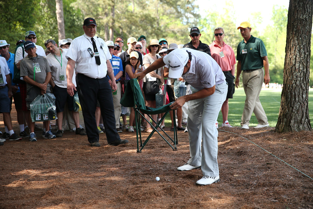 . AUGUSTA, GA - APRIL 13:  Jason Day of Australia examines his lay on the fifth hole during the third round of the 2013 Masters Tournament at Augusta National Golf Club on April 13, 2013 in Augusta, Georgia.  (Photo by Andrew Redington/Getty Images)