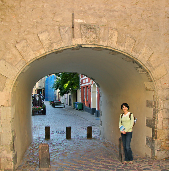 Exploring the mazes of charming cobblestone streets in Riga. This archway is dated 1628. -Riga, Latvia