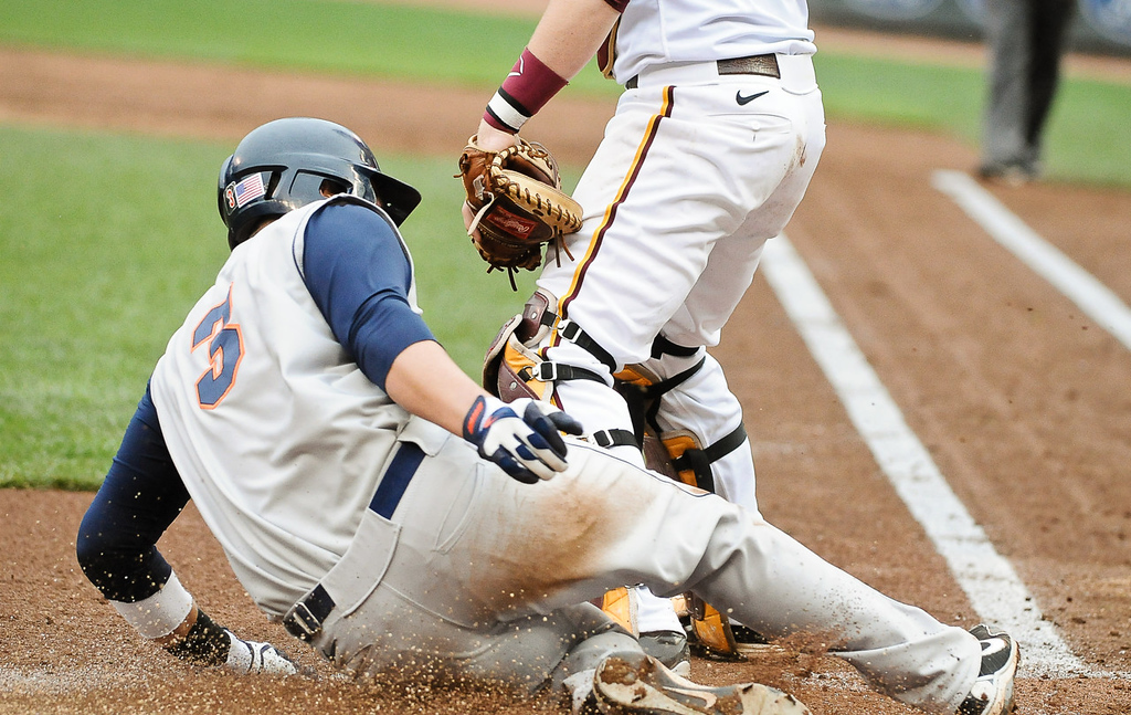 . Illinois\' Brandon Hohl slides past Gophers catcher Matt Halloran for his team\'s first run on a single in the second inning.  (Pioneer Press: Ben Garvin)