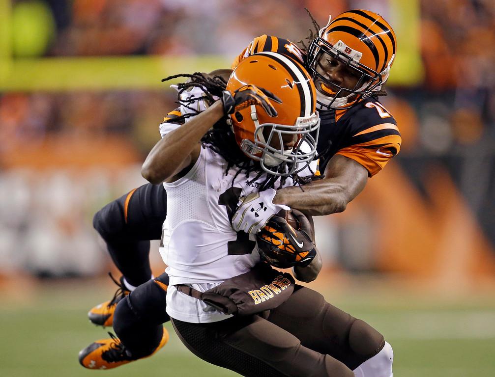 . Cleveland Browns wide receiver Travis Benjamin (11) is tackled by Cincinnati Bengals cornerback Adam Jones (24) during the first half of an NFL football game Thursday, Nov. 6, 2014, in Cincinnati. (AP Photo/AJ Mast)
