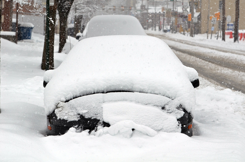 . Snow covered cars on South Broad Street in Lansdale.      Monday, February 3, 2014.  Photo by Geoff Patton