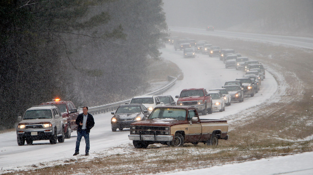 . Vehicles are backed up on a snow covered US Highway 280 during a snow storm, Tuesday, Jan. 28,  2014 in Chelsea, Ala.   (AP Photo/Hal Yeager)