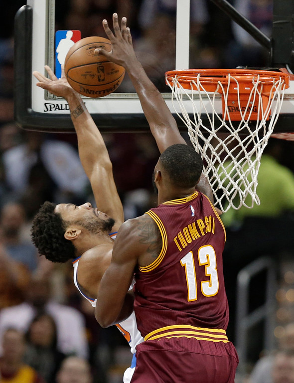 . Cleveland Cavaliers\' Tristan Thompson, right, blocks a shot by New York Knicks\' Derrick Rose during the first half of an NBA basketball game, Thursday, Feb. 23, 2017, in Cleveland. The Cavaliers won 119-104. (AP Photo/Tony Dejak)