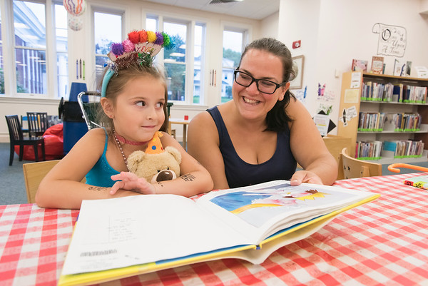 08/13/18 Wesley Bunnell   Staff Adelia Spencer smiles after finishing reading the book I Want Two Birthdays with her mother Becky as she celebrated her sixth birthday at the Bristol Public Library on Monday afternoon.