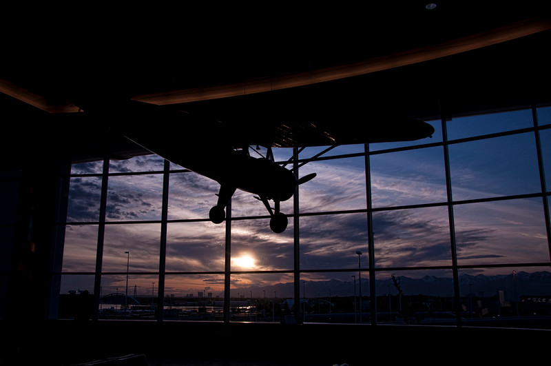 Anchorage airport at sunset.   (Plane is hanging in the airport)