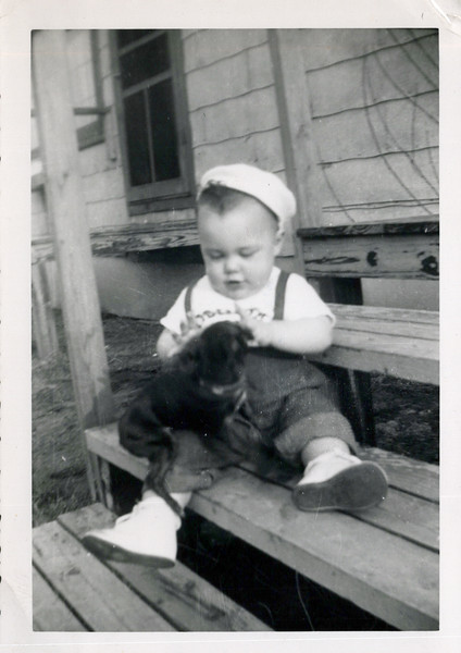 1950 Butch with black puppy on steps.jpeg