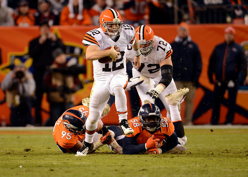 . Cleveland Browns quarterback Colt McCoy (12) scrambles out of the pocked for a gain in the second half.  The Denver Broncos vs Cleveland Browns at Sports Authority Field Sunday December 23, 2012. John Leyba, The Denver Post