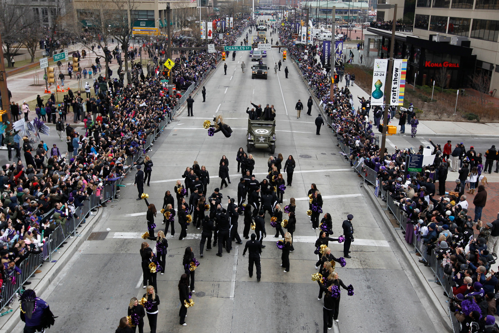 Description of . The Baltimore Ravens Super Bowl victory parade makes its way through the streets of Baltimore on February 5, 2013.  The Ravens defeated the San Francisco 49's in the Super Bowl to win the NFL Championship in New Orleans on February 3.  MOLLY RILEY/AFP/Getty Images