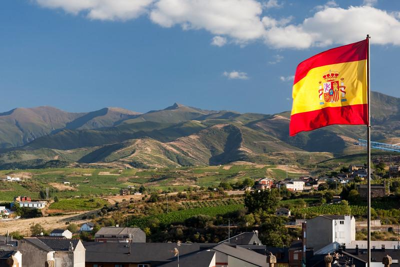 The flag of Spain waving on the top of the Templar castle, town of Ponferrada, El Bierzo region, province of Leon, autonomous community of Castilla and Leon, northern Spain