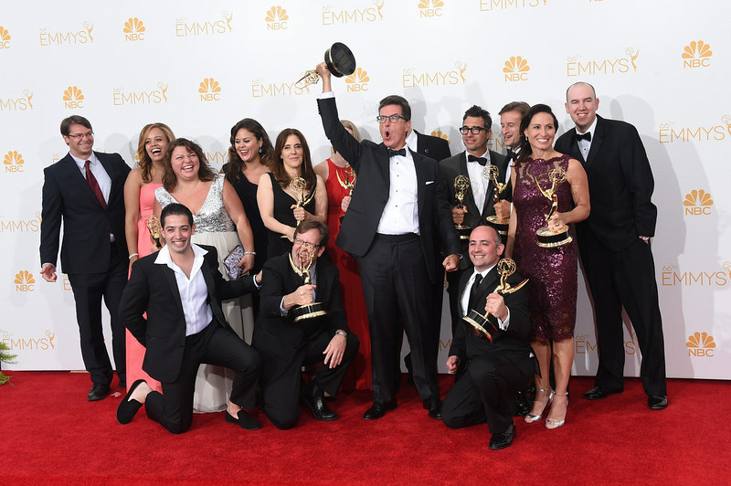 . Writer/Producer/Host Stephen Colbert (C) and the writing staff, winners of the for Outstanding Variety Series Award for The Colbert Report, pose in the press room during the 66th Annual Primetime Emmy Awards held at Nokia Theatre L.A. Live on August 25, 2014 in Los Angeles, California.  (Photo by Jason Merritt/Getty Images)