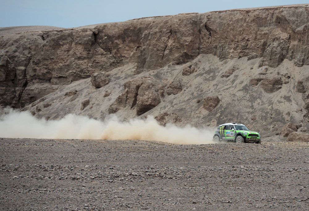 Description of . Stephane Peterhansel and co-driver Jean Paul Cottret of team Mini compete in stage 6 from Arica to Calama during the 2013 Dakar Rally on January 10, 2013 in Arica, Chile.  (Photo by Shaun Botterill/Getty Images)