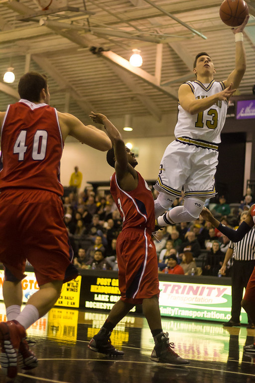 . Baenzinger goes for the lay-up. Photos by Dylan Dulberg/The Oakland Press