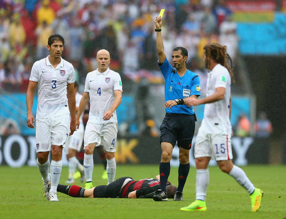 . Omar Gonzalez of the United States is shown a yellow card by referee Ravshan Irmatov after a foul on Bastian Schweinsteiger of Germany during the 2014 FIFA World Cup Brazil group G match between the United States and Germany at Arena Pernambuco on June 26, 2014 in Recife, Brazil.  (Photo by Michael Steele/Getty Images)