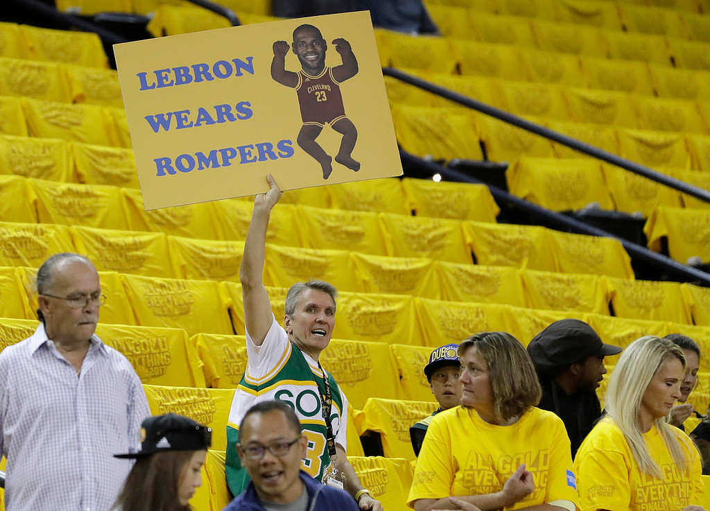 . A fan holds up a sign for Cleveland Cavaliers forward LeBron James before Game 2 of basketball\'s NBA Finals between the Golden State Warriors and the Cavaliers in Oakland, Calif., Sunday, June 4, 2017. (AP Photo/Marcio Jose Sanchez)