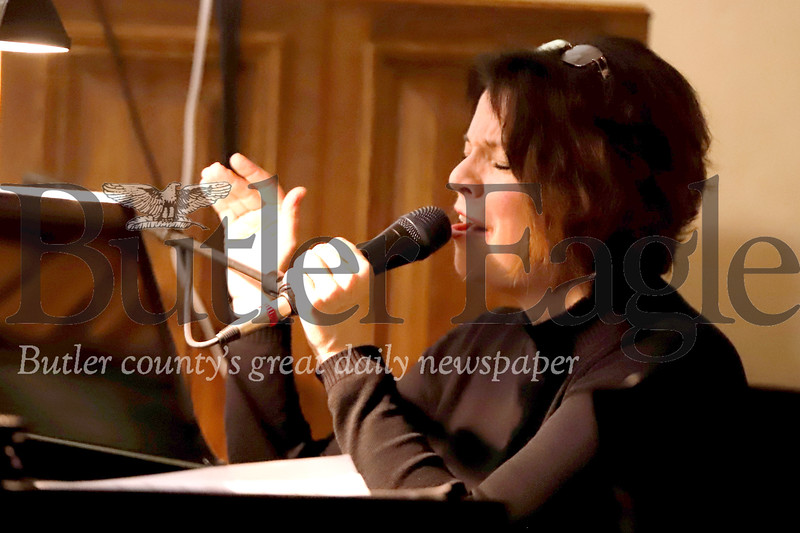 "Donna Groom of the Skyliners sings during her ""Love Letters"" show  Saturday at St. John's United Church of Christ in Evan's City. The show is a look at the wartime letters of servicemen and women and their families, accompanied by the music of the era. Groom, the female vocalist of the Skyliners, is the principal artist and creator."