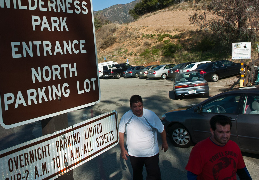 . Two joggers exit the Claremont Hills Wilderness Park as two vehicles enter the parking lot of the park. (Staff photo/Inland Valley Daily Bulletin)