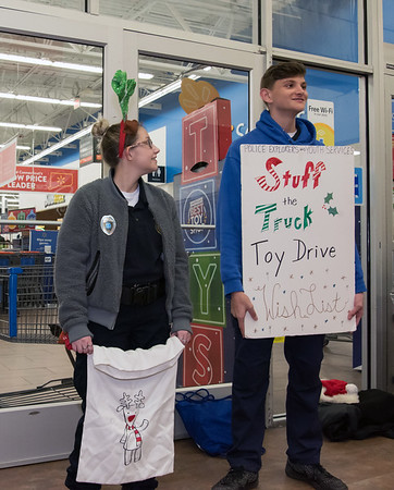 12/03/18 Wesley Bunnell | Staff The Bristol Police Explorers held their annual toy drive outside of Walmart on Monday evening. Bristol Eastern Students and Police Explorers Lejla Wesche, L, and Damian Martin hold signs inside the entrance.