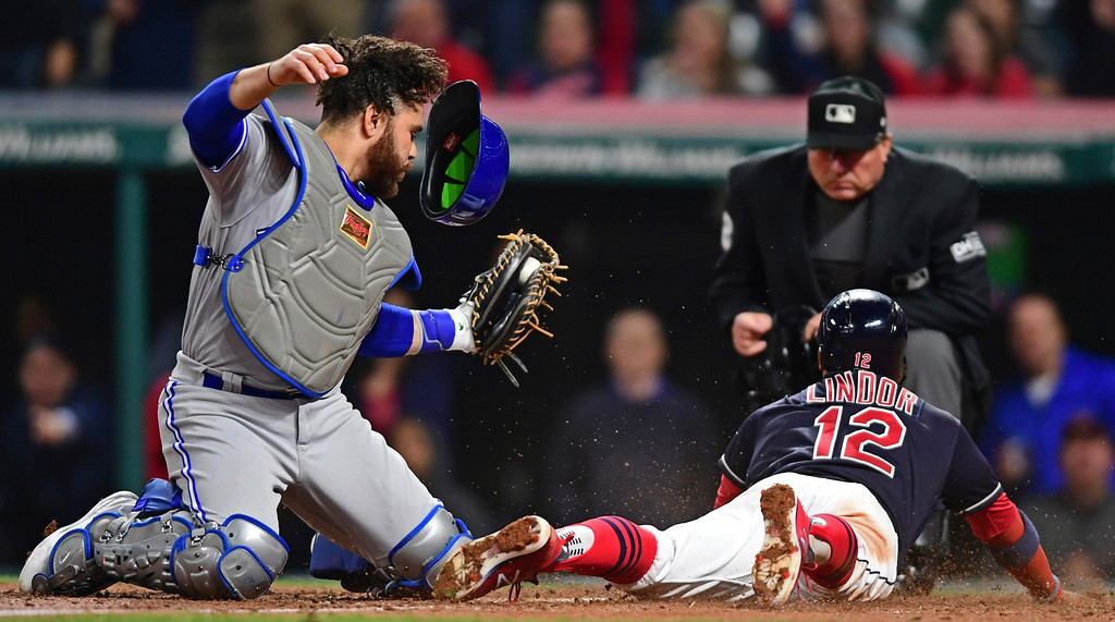 . Toronto Blue Jays\' Russell Martin tags out Cleveland Indians\' Francisco Lindor during the sixth inning of a baseball game Friday, April 13, 2018, in Cleveland. (AP Photo/David Dermer)