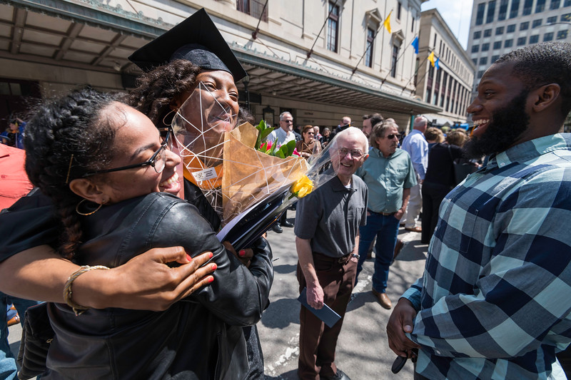 Alexandria Kelley celebrates with friends Ana Maneiro, left and Faybian Robert William Byrd after the ceremony. // University of Rochester School of Nursing Commencement, Kodak Hall at Eastman Theatre May 17, 2019.  // photo by J. Adam Fenster / University of Rochester