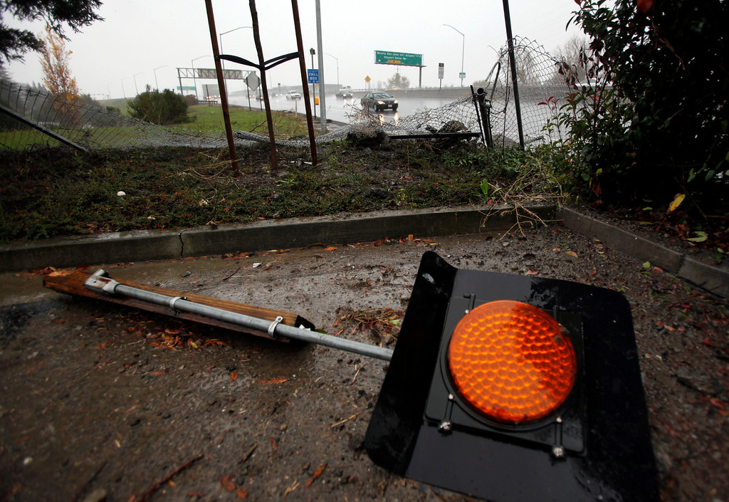. The remnants of an early morning accident sit off Highway 87 in San Jose, Calif., during the morning\'s storm on Thursday, Dec. 11, 2014. (Karl Mondon/Bay Area News Group)