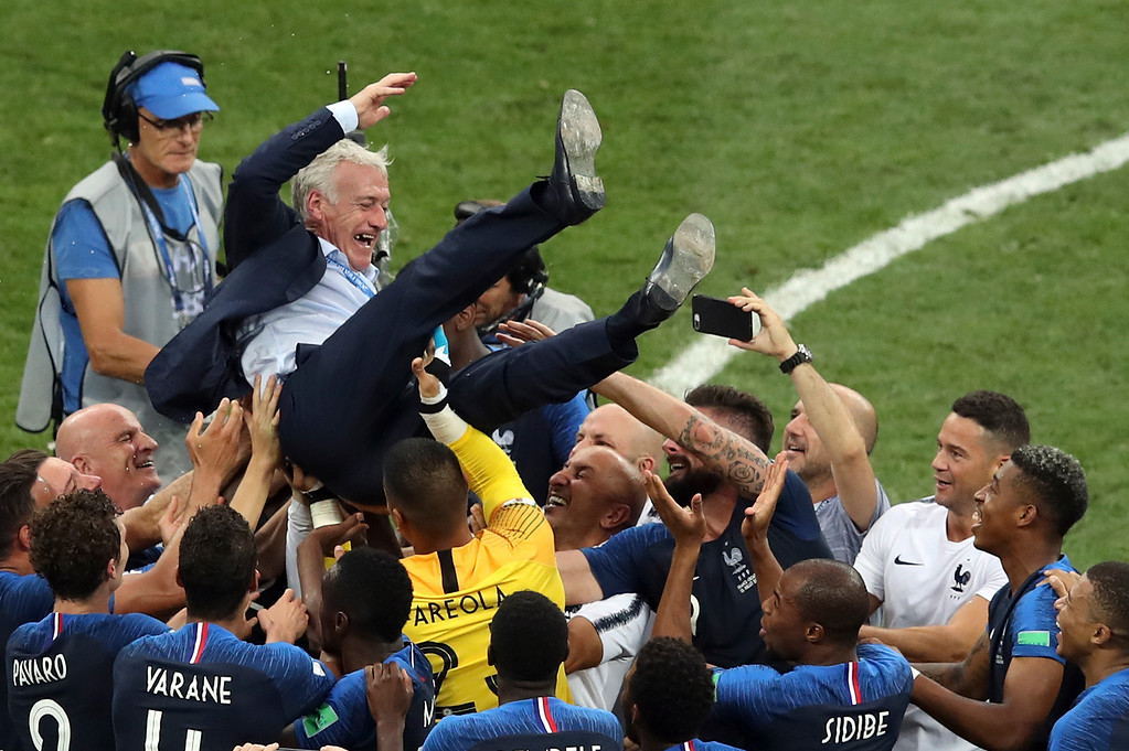 . French players throw France head coach Didier Deschamps into the air celebrating at the end of the final match between France and Croatia at the 2018 soccer World Cup in the Luzhniki Stadium in Moscow, Russia, Sunday, July 15, 2018. (AP Photo/Thanassis Stavrakis)