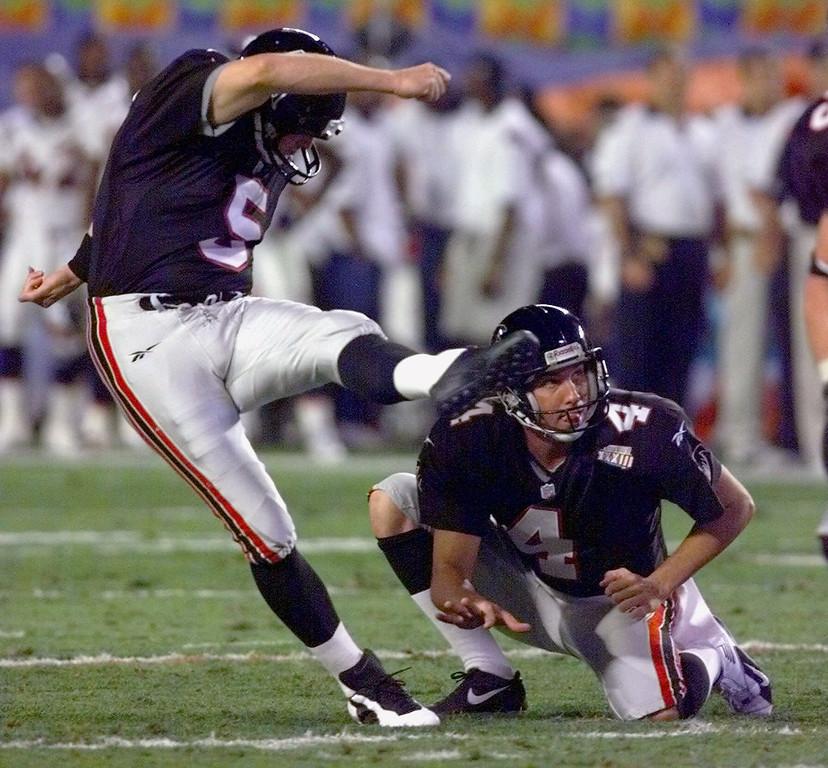 . Atlanta Falcons kicker Morten Andersen kicks a field goal as Dan Stryzinski looks on during  second quarter action at of Super Bowl XXXIII against the Denver Broncos in Miami, Sunday, Jan. 31, 1999. Andersen missed the goal. (AP Photo/Ed Reinke)