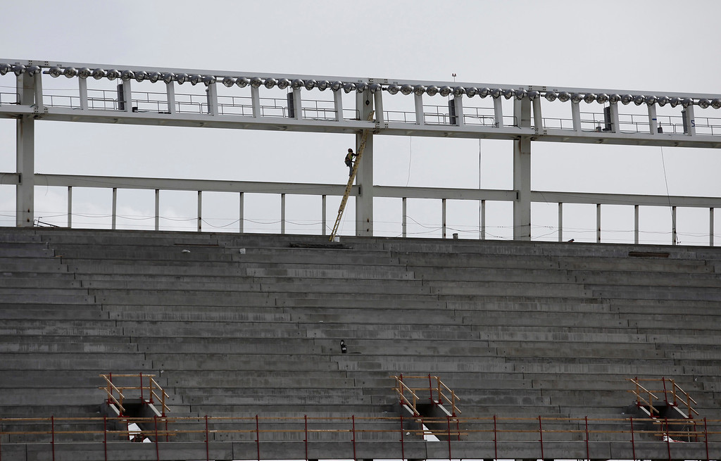 . A worker checks the lights at the new 49ers stadium in Santa Clara, Calif. on Wednesday, March 6, 2013. The Super Bowl Host Committee is competing against Miami for the bragging rights of hosting the 50th Super Bowl in 2016.  (Gary Reyes/ Staff)