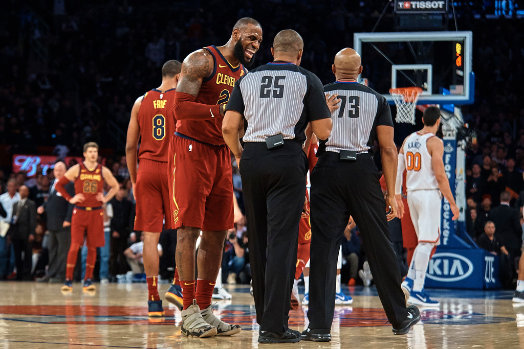 . Cleveland Cavaliers\' LeBron James, center left, complains to the referee during the first half of a NBA basketball game against New York Knicks at Madison Square Garden in New York, Monday, Nov. 13, 2017. (AP Photo/Andres Kudacki)