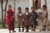 This was taken at a festival. Most of the adults were drunk, and the young-uns were playing with toy guns. The one on the left is a monk-to-be, the others are in traditional Bhutanese dress.