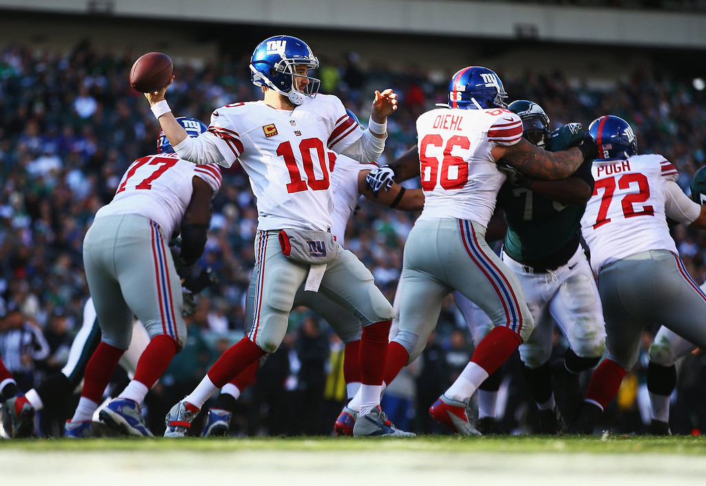 . Eli Manning #10 of the New York Giants passes against the Philadelphia Eagles during their game at Lincoln Financial Field on October 27, 2013 in Philadelphia, Pennsylvania.  (Photo by Al Bello/Getty Images)