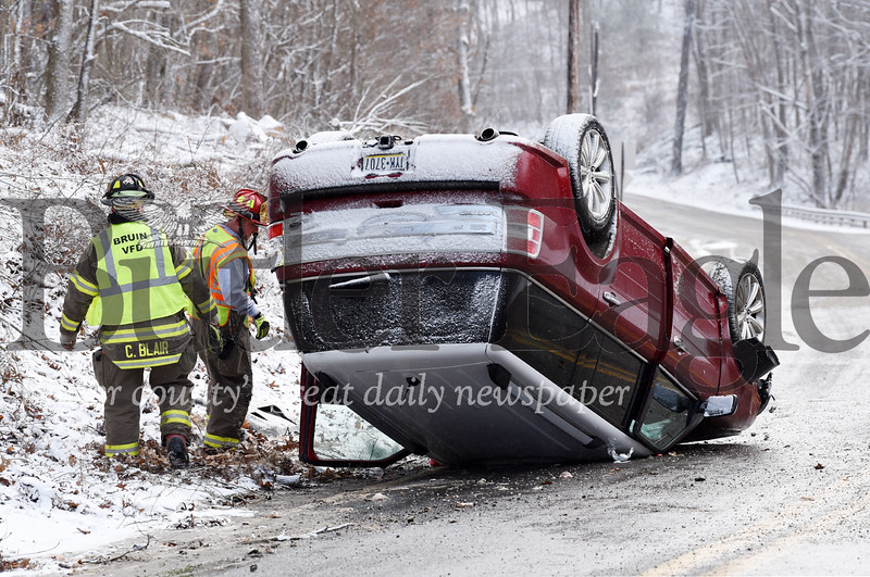 Harold Aughton/Butler Eagle: A woman and her children were taken to local hospitals after their Ford Flex flipped onto its roof on Bruin Road Wednesday, January 8, 2020.