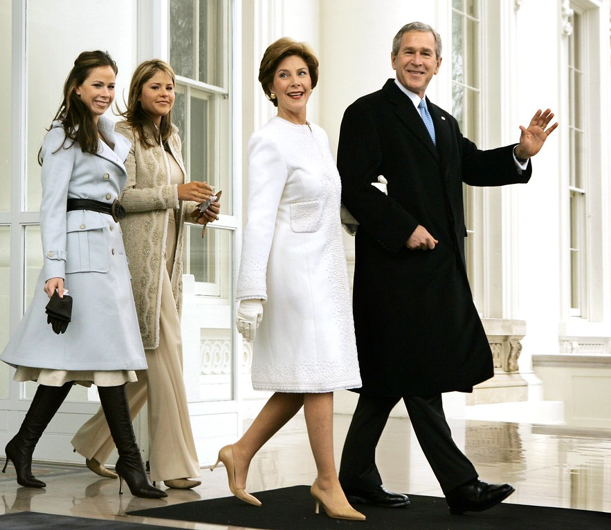 . President George W. Bush and first lady Laura Bush depart the North Portico of the White House for the limousine ride to the Capitol where he will take the Oath of Office and begin his second term, in Washington, Thursday, Jan. 20, 2005. They are joined by their daughters Barbara, far left, and Jenna.  (AP Photo/J. Scott Applewhite)