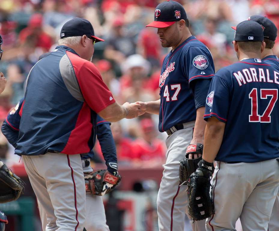 . Minnesota Twins manager Ron Gardenhire takes the ball from pitcher Ricky Nolasco (#47) as they play the Angels at Angel Stadium in Anaheim on Thursday June 26, 2014. The Angels beat the Minnesota Twins 6-4. (Photo by Keith Durflinger/Whittier Daily News)