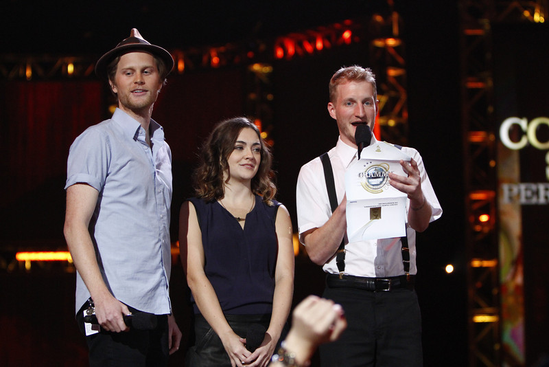 . From left, Wesley Schultz, Neyla Pekarek and Jeremiah Fraites, of musical group The Lumineers, announce the nominees for best country solo perfomance at the Grammy Nominations Concert Live! at Bridgestone Arena on Wednesday, Dec. 5, 2012, in Nashville, Tenn. (Photo by Wade Payne/Invision/AP)