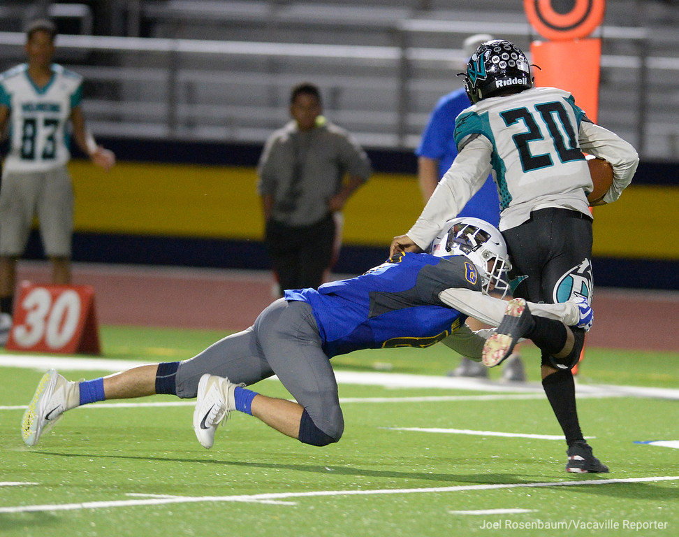 . Wood defensive back, Isaac Pewitt wraps up Deer Valley quarterback,, Joshua Scott after a short gain during the third quarter of the Wildcats 20-8 victory over the Wolverines Friday at Wildcat Stadium.
