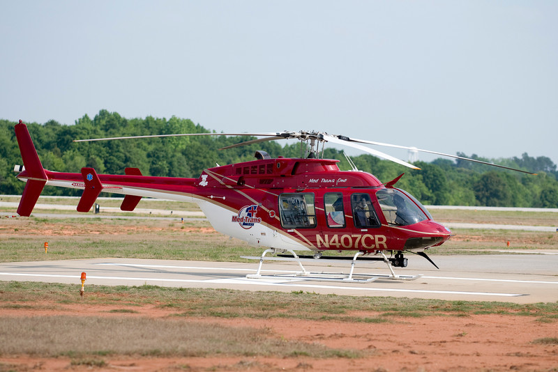 A medical evacuation helicopter sits on the pad, ready to respond to an emergency call.