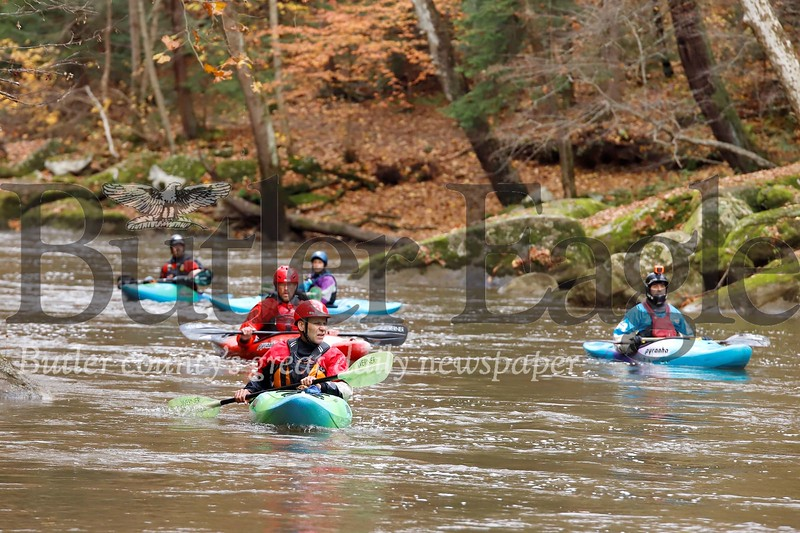 A group of Michigan Kayakers paddle Slippery Rock Creek through McConnells Mill State Park Sunday. The group of boaters made the stop as part of a multi-state paddling trip stopping at whitewater destinations in Pennsylvania, Maryland and West Virginia. Seb Foltz/Butler Eagle