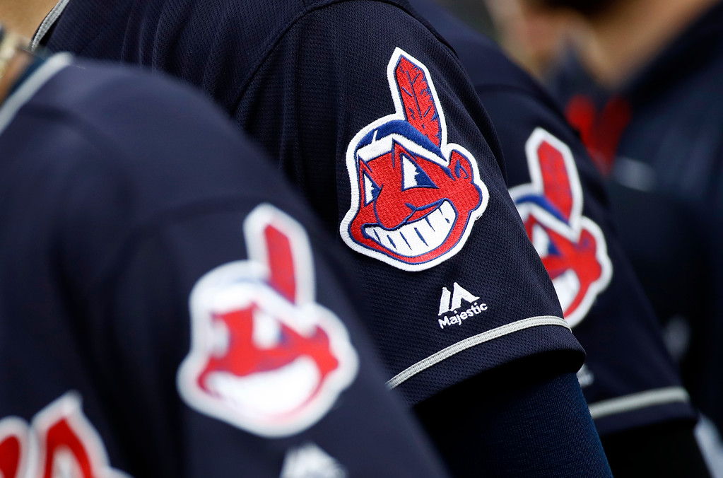 . Members of the Cleveland Indians wear uniforms featuring mascot Chief Wahoo as they stand on the field for the national anthem before a baseball game against the Baltimore Orioles in Baltimore, Monday, June 19, 2017. (AP Photo/Patrick Semansky)