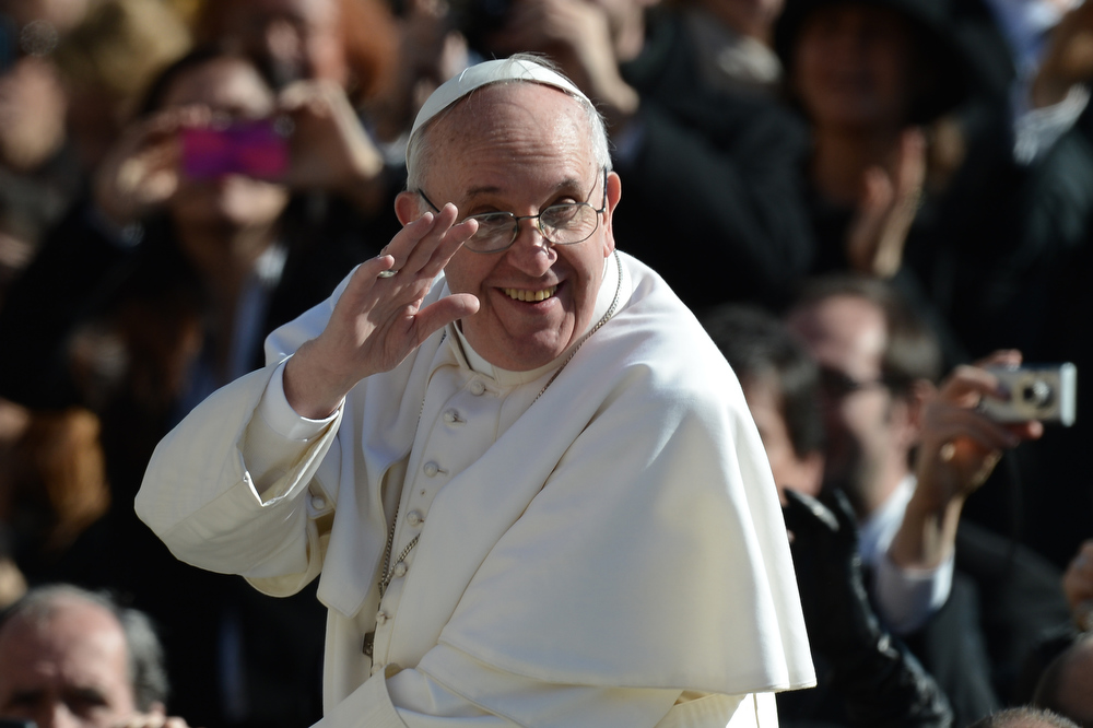 . Pope Francis waves to the crowd from the papamobile during his inauguration mass at St Peter\'s square on March 19, 2013 at the Vatican. World leaders flew in for Pope Francis\'s inauguration mass in St Peter\'s Square on Tuesday where Latin America\'s first pontiff will receive the formal symbols of papal power.  FILIPPO MONTEFORTE/AFP/Getty Images