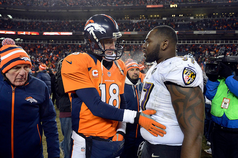 . Denver Broncos quarterback Peyton Manning (18) talks to Baltimore Ravens defensive end Arthur Jones (97) as he walks off the field after losing to the Baltimore Ravens 35 to 38.  The Denver Broncos vs Baltimore Ravens AFC Divisional playoff game at Sports Authority Field Saturday January 12, 2013. (Photo by Tim Rasmussen,/The Denver Post)
