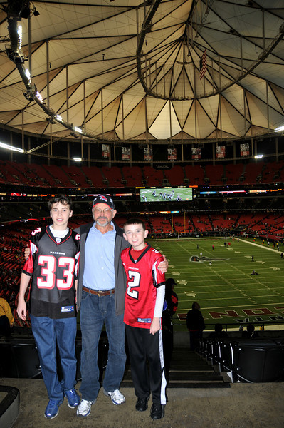 Arturo with grandkids at the Falcons Game.jpg