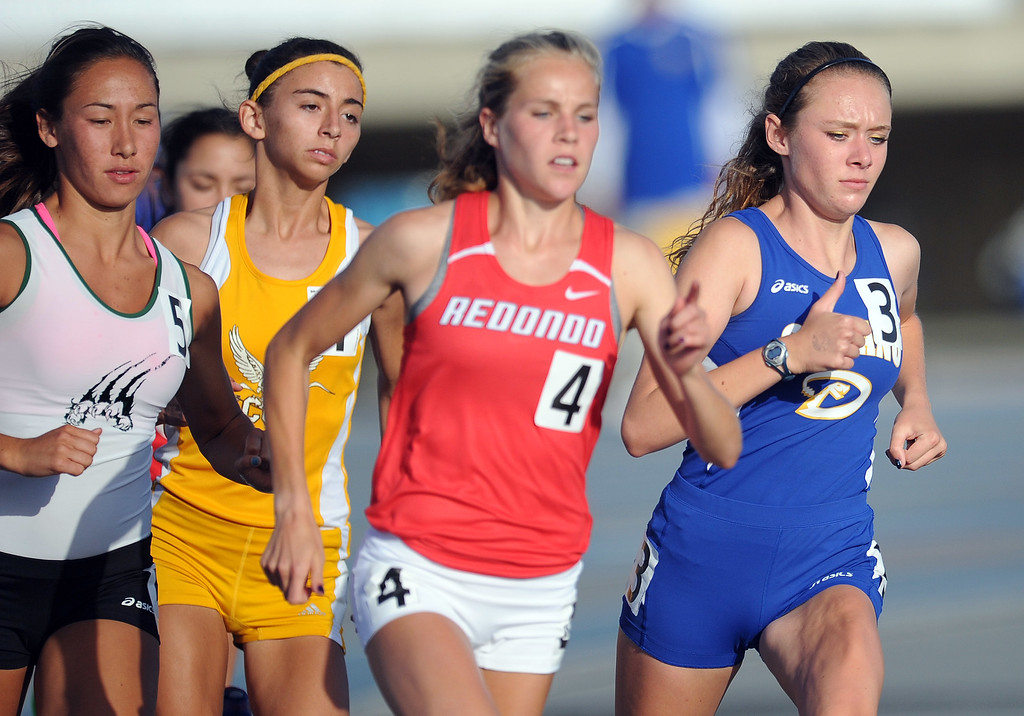 . Serrano\'s Melissa Fairchild, right, in the 1600 meter race during the CIF-SS Masters Meet at Cerritos College on Friday, May 24, 2013 in Norwalk, Calif.  (Keith Birmingham Pasadena Star-News)