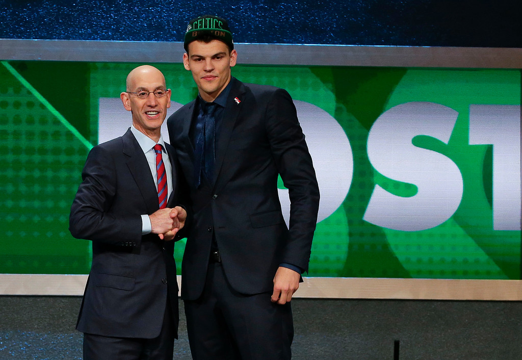 . Ante Zizic, right, poses for a photo with NBA Commissioner Adam Silver after being selected 23rd overall by the Boston Celtics during the NBA basketball draft, Thursday, June 23, 2016, in New York. (AP Photo/Frank Franklin II)