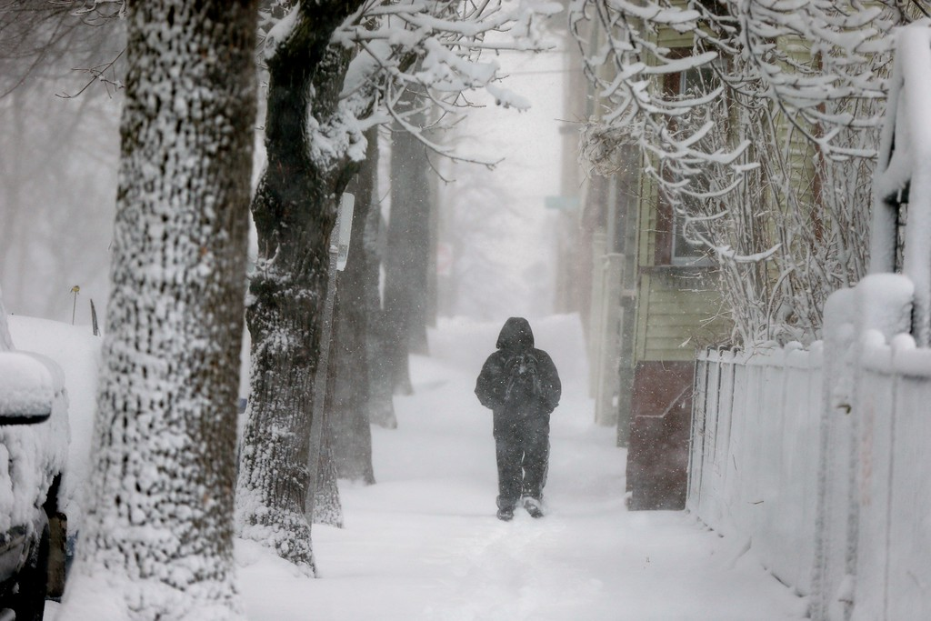 . A man walks on Cottage Street in Boston, Tuesday, March 13, 2018. Boston finds itself in the bullseye of the third nor\'easter in two weeks, with forecasters warning of up to 18 inches of snow and 2 feet or more to the south. (AP Photo/Michael Dwyer)