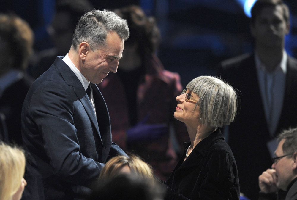 Description of . Actor Daniel Day-Lewis (L) and guest in the audience at the 18th Annual Critics' Choice Movie Awards held at Barker Hangar on January 10, 2013 in Santa Monica, California.  (Photo by Kevin Winter/Getty Images)