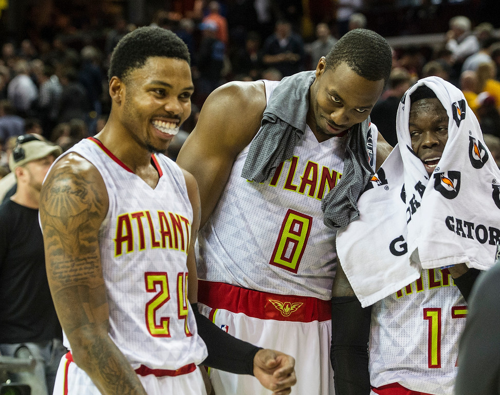 . Atlanta Hawks\' Kent Bazemore (24), Dwight Howard (8), and Dennis Schroder, right, fool around after defeating the Cleveland Cavaliers in an NBA basketball game in Cleveland, Tuesday, Nov. 8, 2016. (AP Photo/Phil Long)