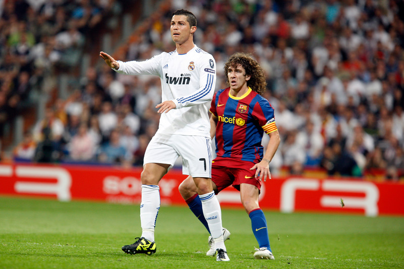 Pujol watching Cristiano Ronaldo, UEFA Champions League Semifinals game between Real Madrid and FC Barcelona, Bernabeu Stadiumn, Madrid, Spain