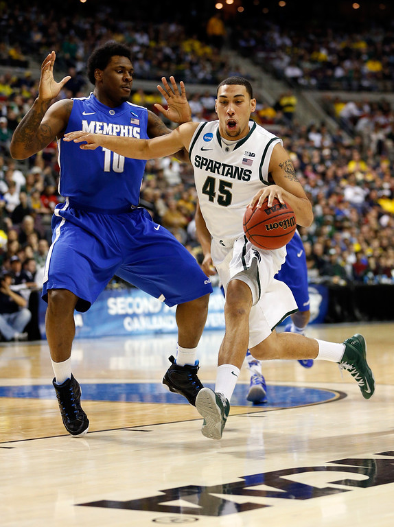 . AUBURN HILLS, MI - MARCH 23:  Denzel Valentine #45 of the Michigan State Spartans drives in the first half agianst Tarik Black #10 of the Memphis Tigers during the third round of the 2013 NCAA Men\'s Basketball Tournament at The Palace of Auburn Hills on March 23, 2013 in Auburn Hills, Michigan.  (Photo by Gregory Shamus/Getty Images)
