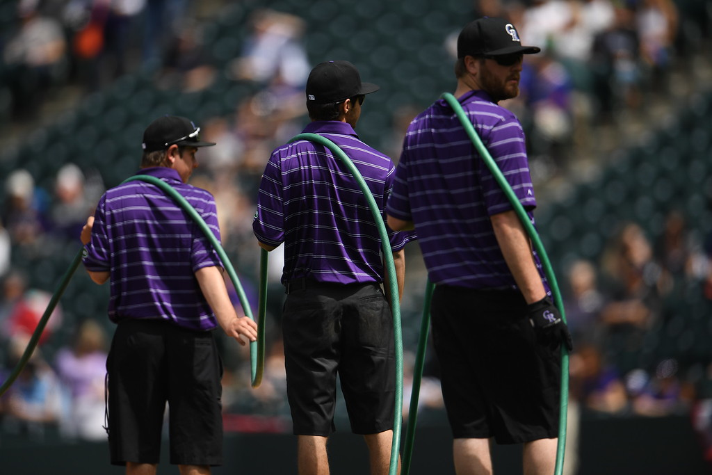 . Rockies crew members water down the field before the game. The Colorado Rockies played the San Diego Padres Friday, April 8, 2016 on opening day at Coors Field in Denver, Colorado. (Photo By RJ Sangosti/The Denver Post)