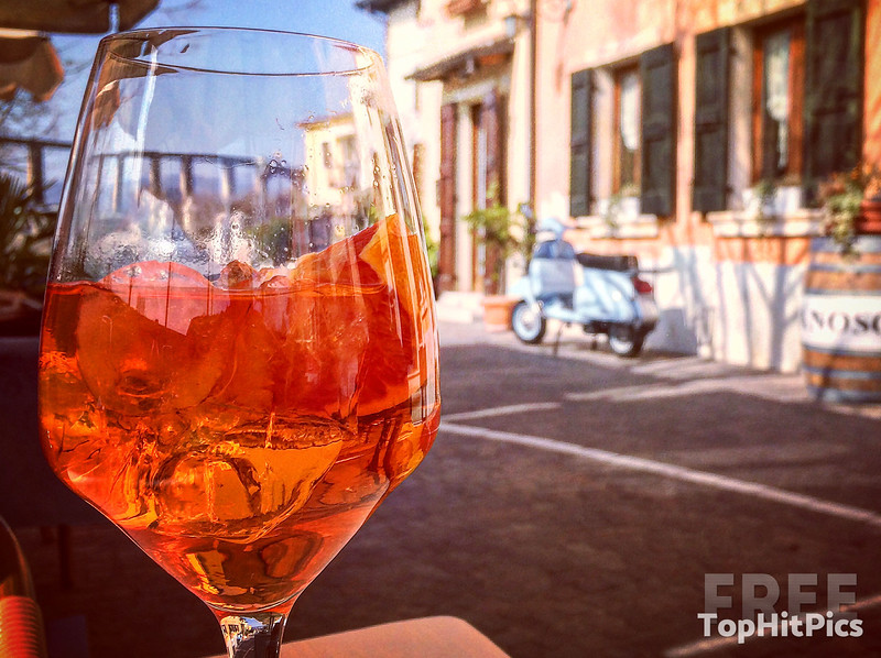 An Aperol Spritz with a Vespa in the background...Ciao!